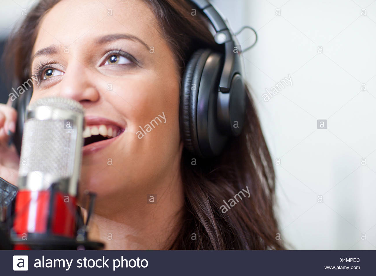 Close up of young female singer - Stock Image