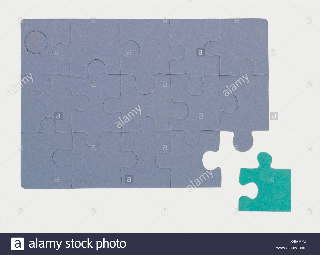 Jigsaw puzzle with unfitting final piece, symbolic of an outsider - Stock Image