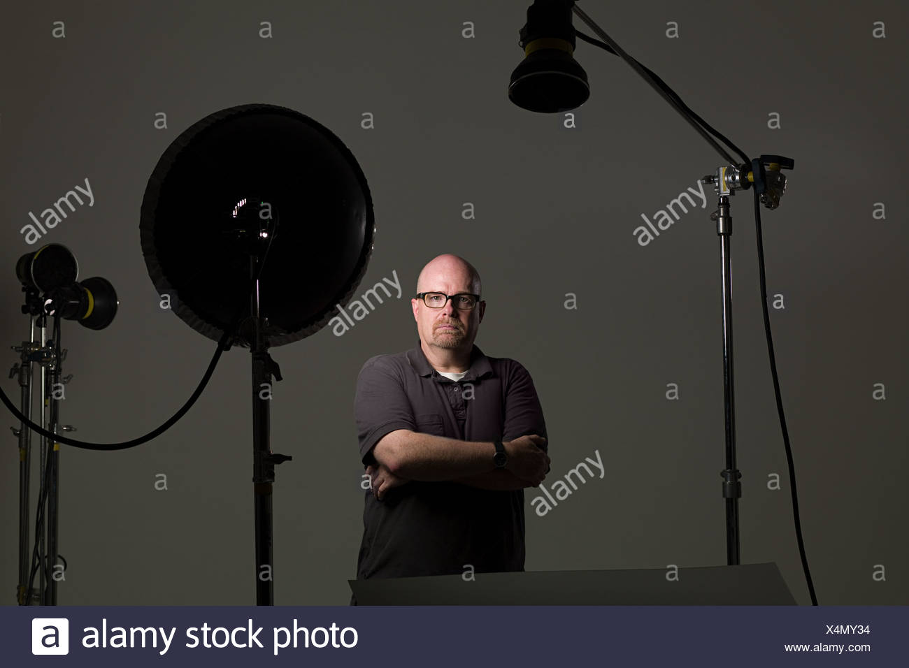Portrait of a man next to photographic equipment - Stock Image