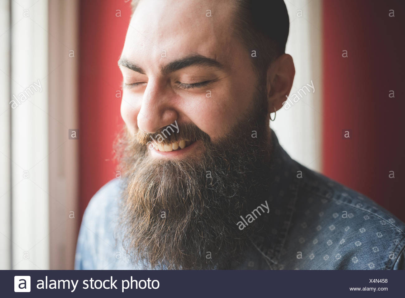 Portrait of young bearded man - Stock Image