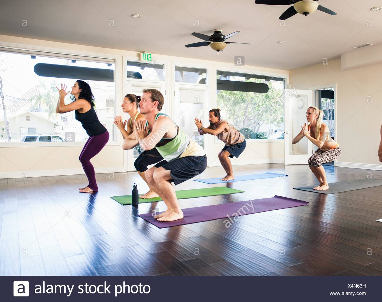 Five people in yoga class Stock Photo