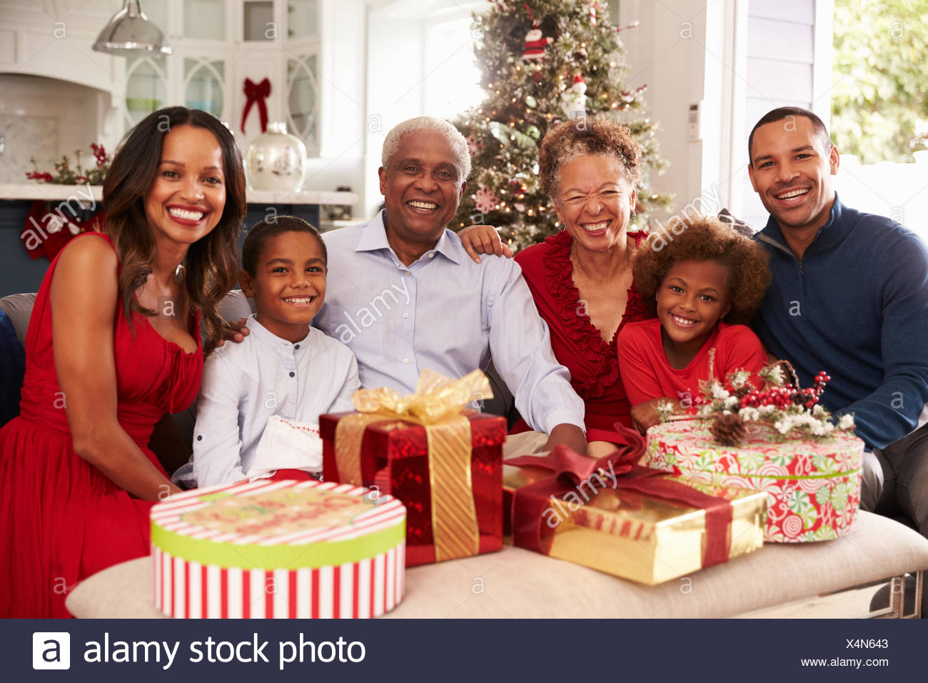 Family With Grandparents Opening Christmas Gifts Stock Photo ...