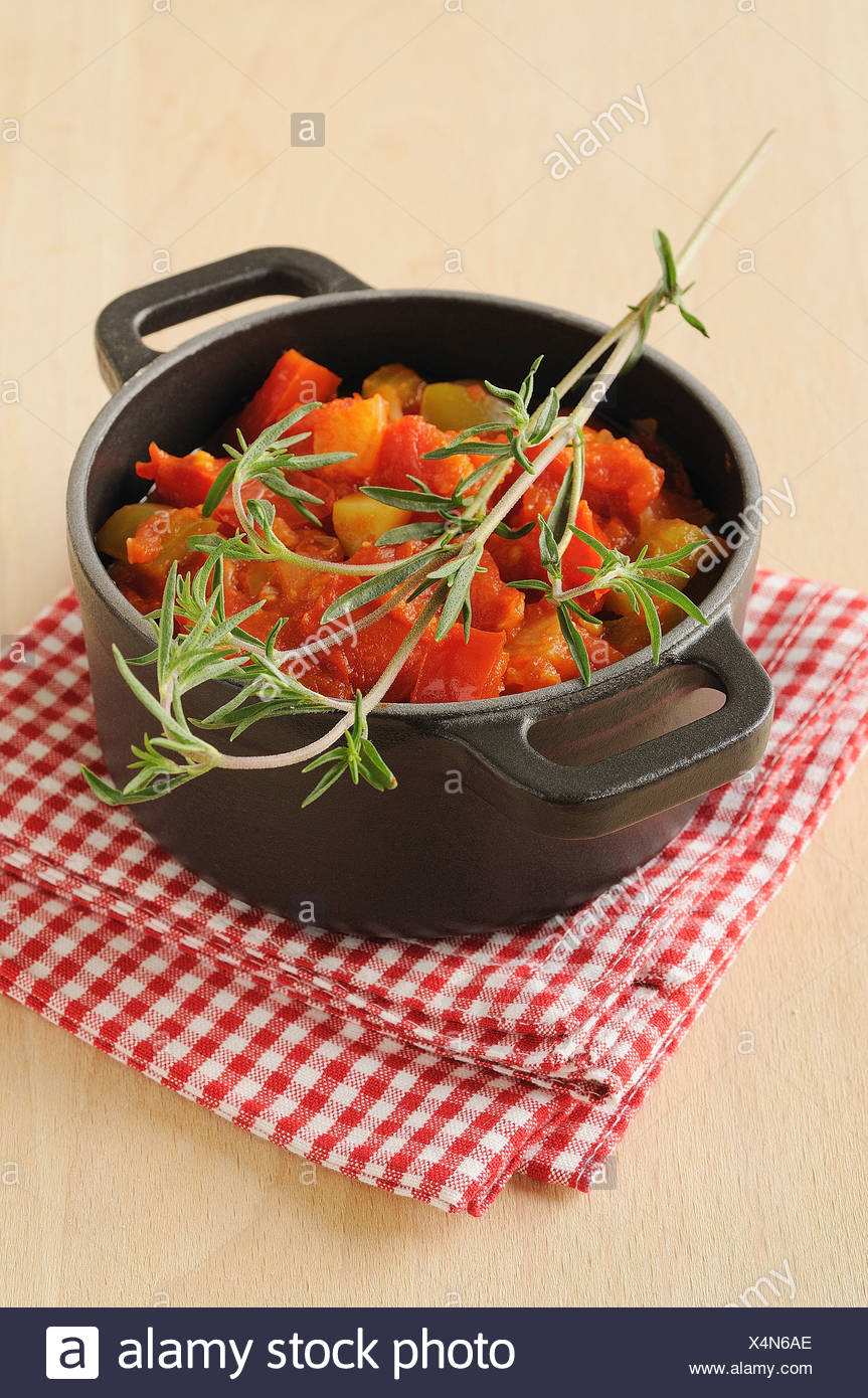 Stewed vegetables with savory - Stock Image