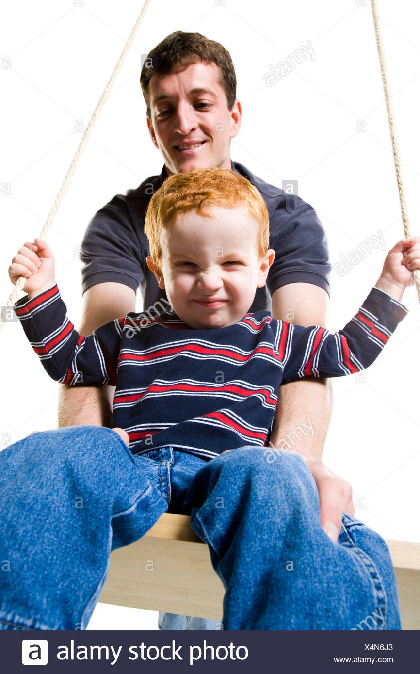 Father with son on swing - Stock Image