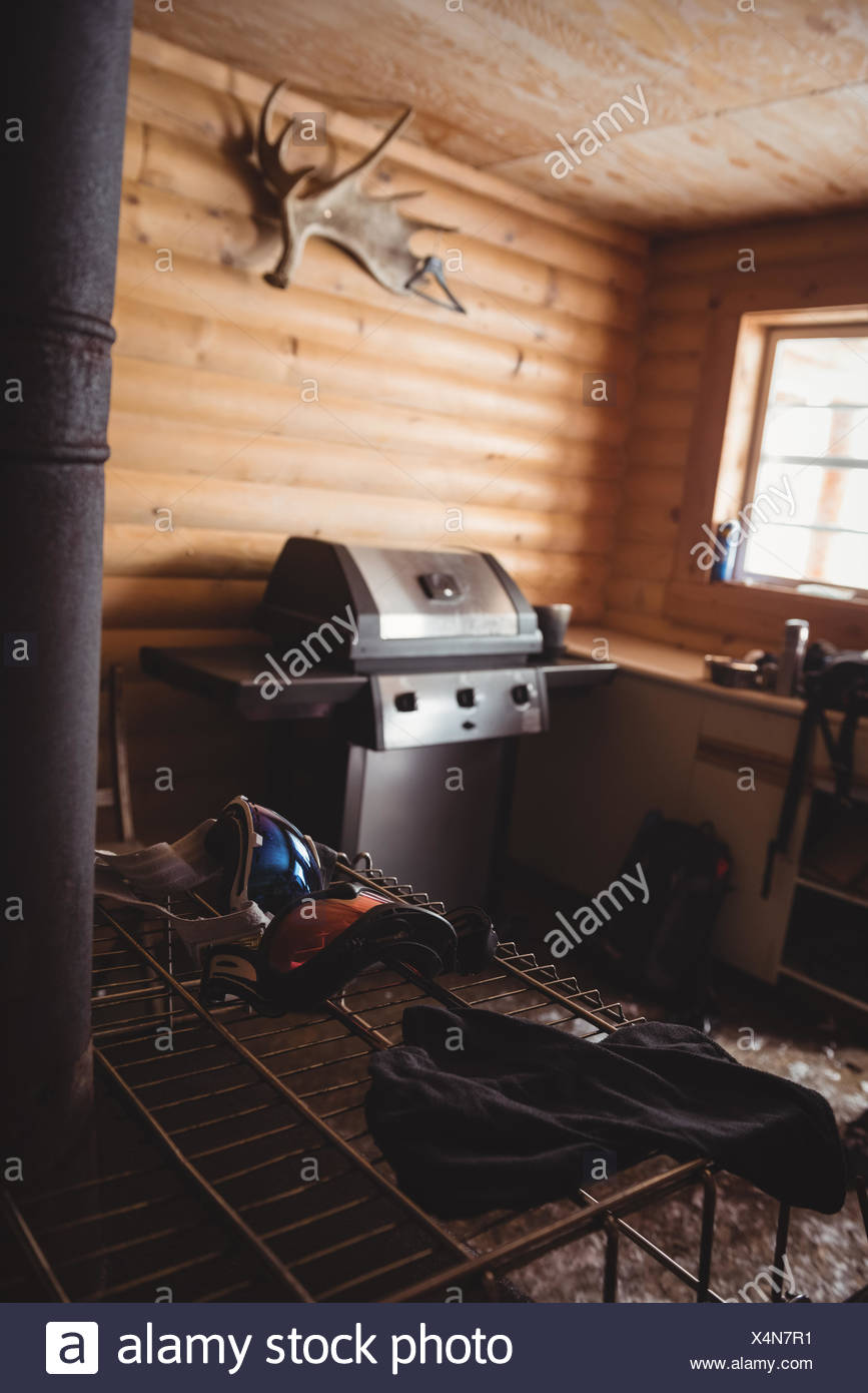 Empty log cabin with snow goggles - Stock Image