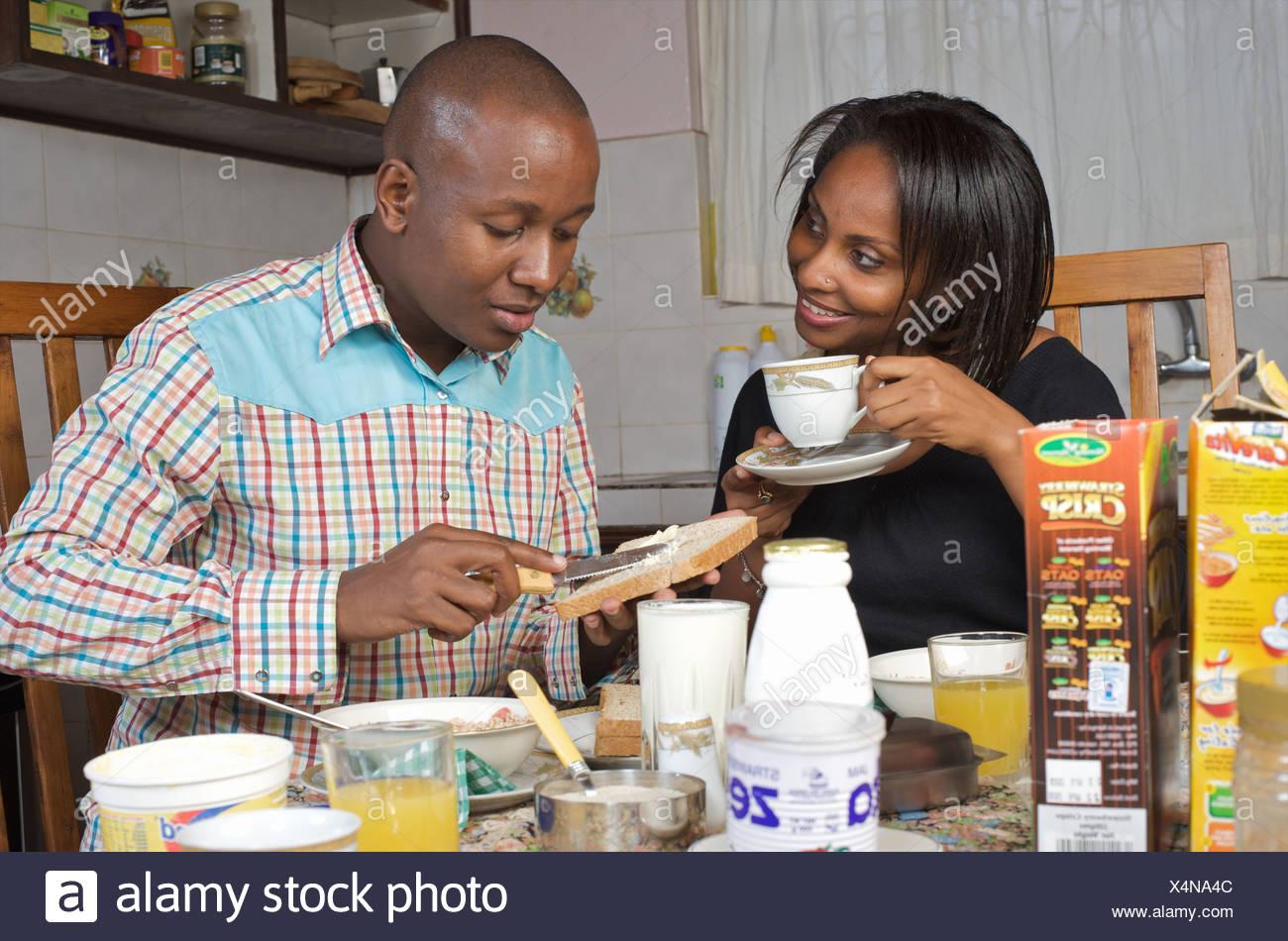 Kenyan couple sharing breakfast, Nairobi, Kenya Stock Photo