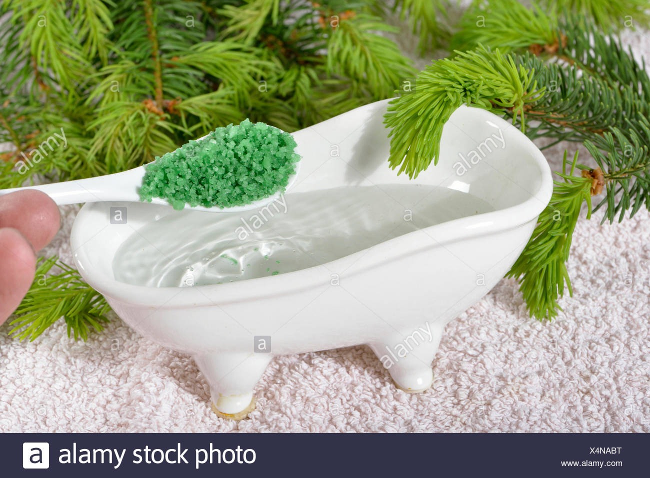 Foam bath with spruce concentrate - Stock Image