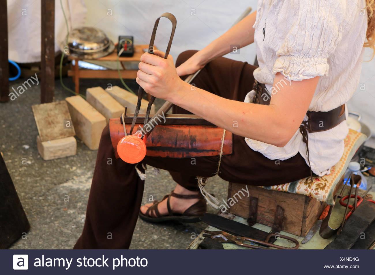Glass Blower. Formatting glass paste. - Stock Image