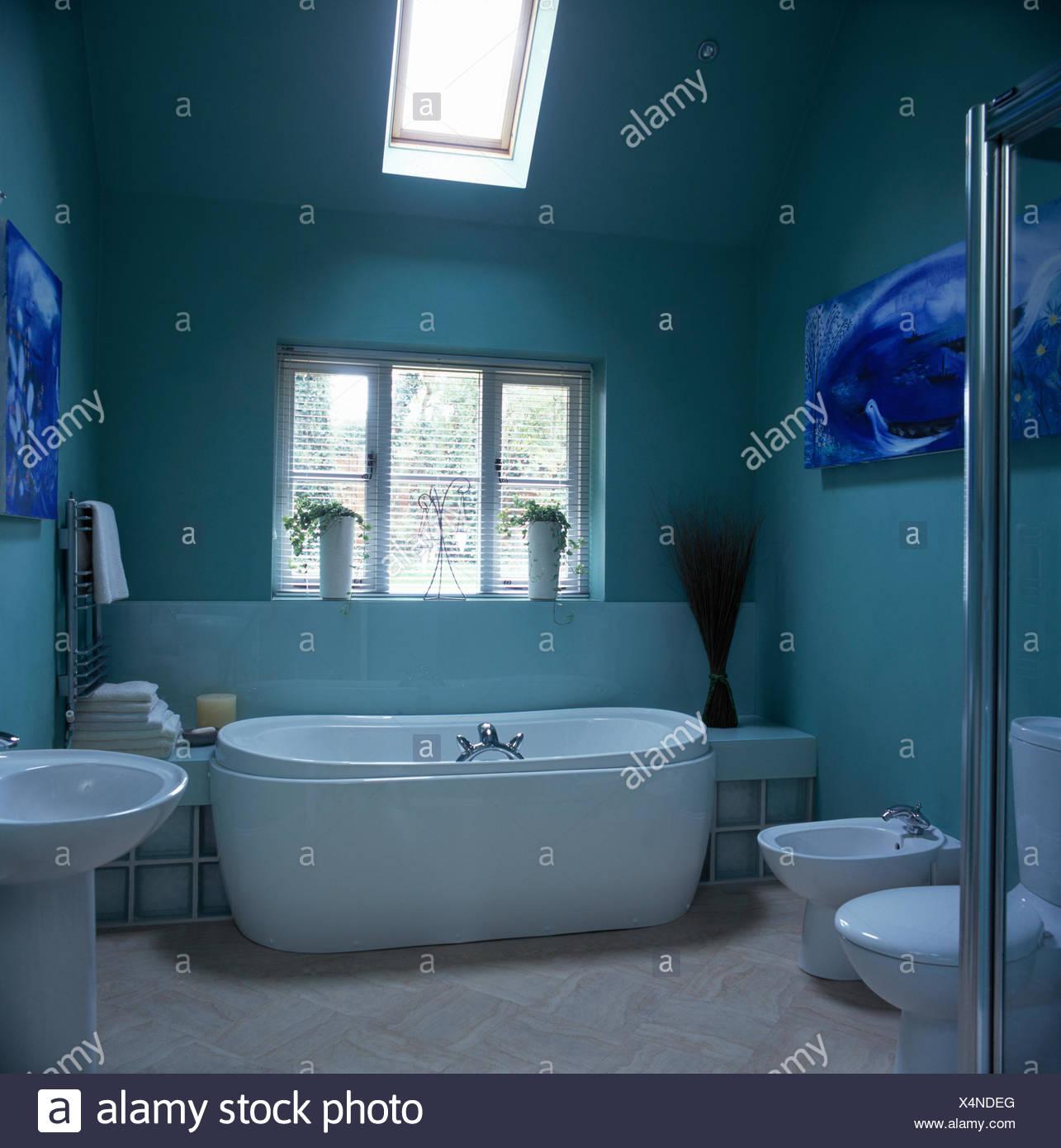 Freestanding bath in pale blue nineties bathroom Stock Photo ...