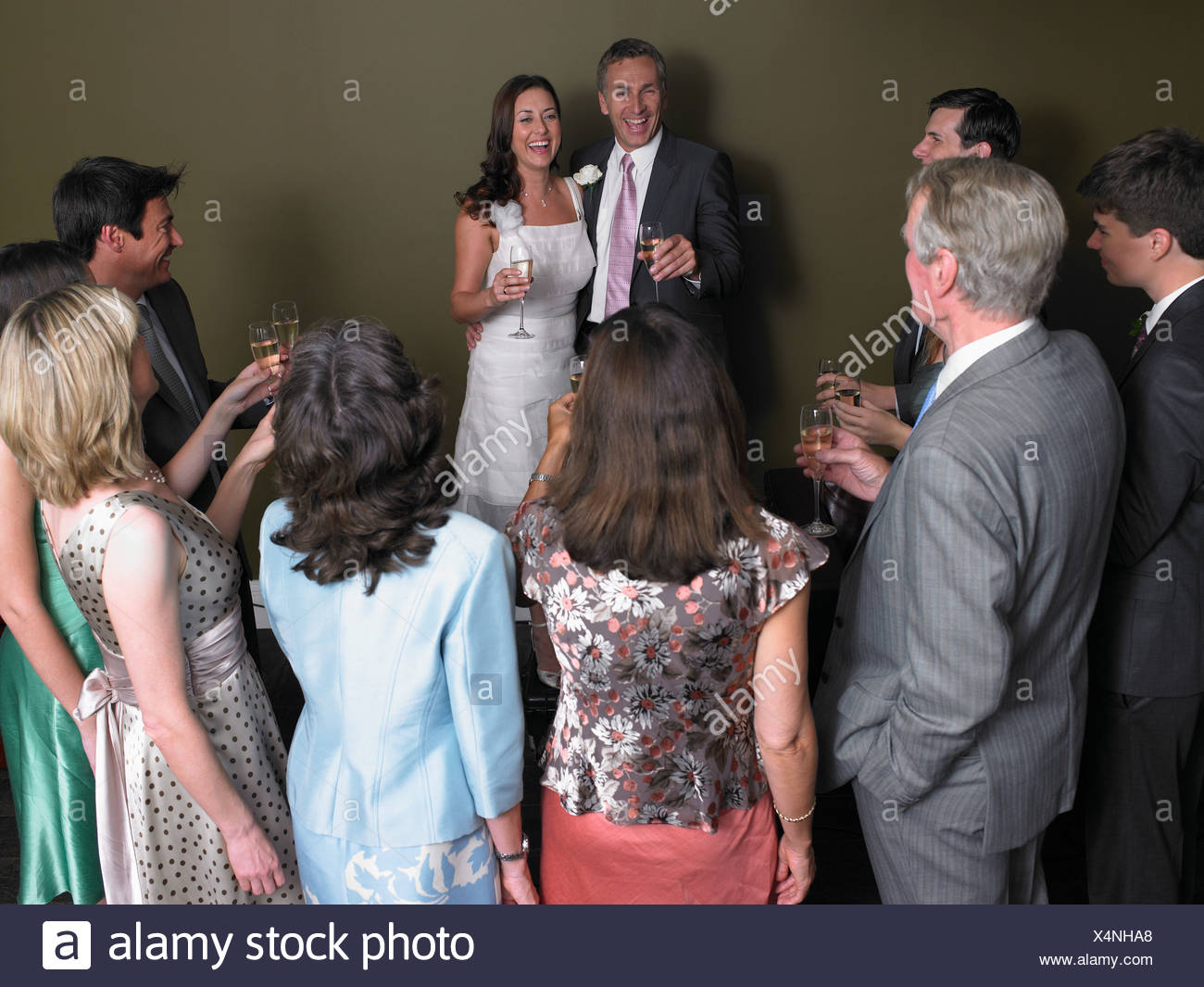 Wedding guests toasting the bride and groom - Stock Image