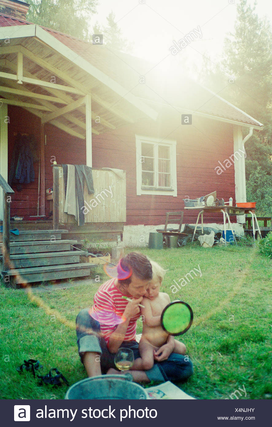 A mother and son in front of their summer house, Sweden. - Stock Image