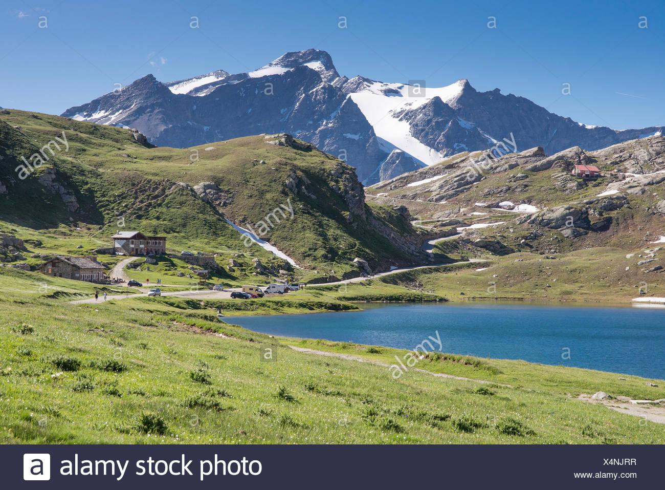 Plateau with mountain hut Rifugio Savoia, pass road Colle del Nivolet, National Park Gran Paradiso, Ceresole realale, Piedmont Stock Photo