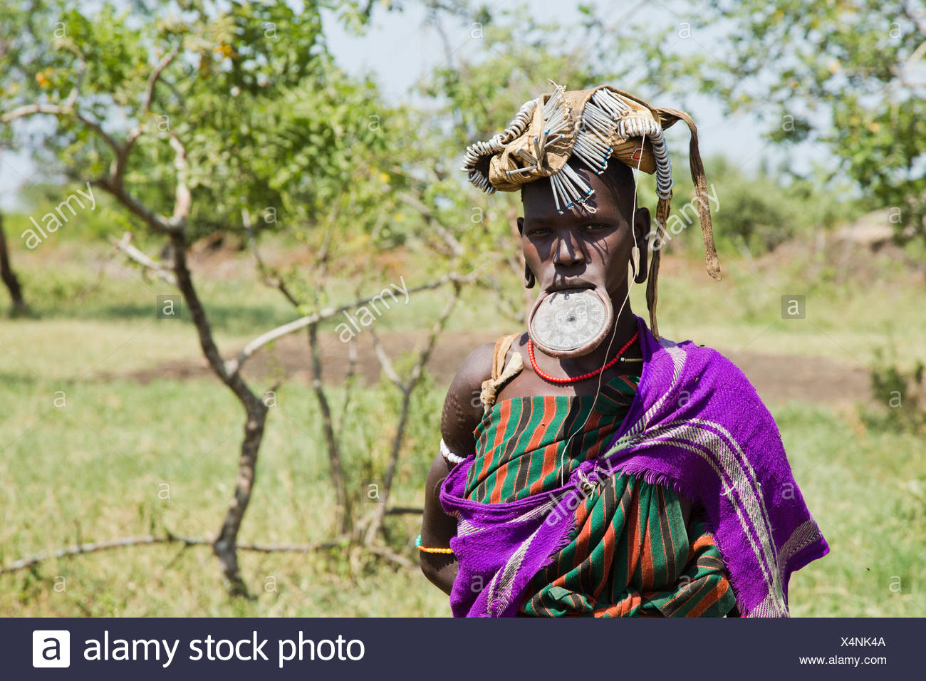 Woman of the Mursi tribe with clay lip disc as body ornamentstribe Debub Omo Zone, Ethiopia. Close to the Sudanese border. - Stock Image