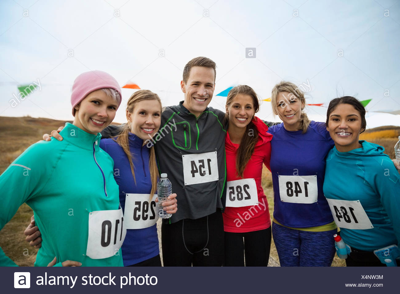 Portrait of confident marathon runners - Stock Image