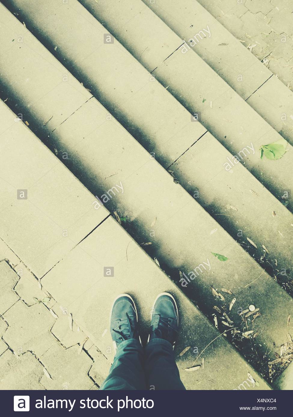 High Angle View Of Man Standing On Steps - Stock Image
