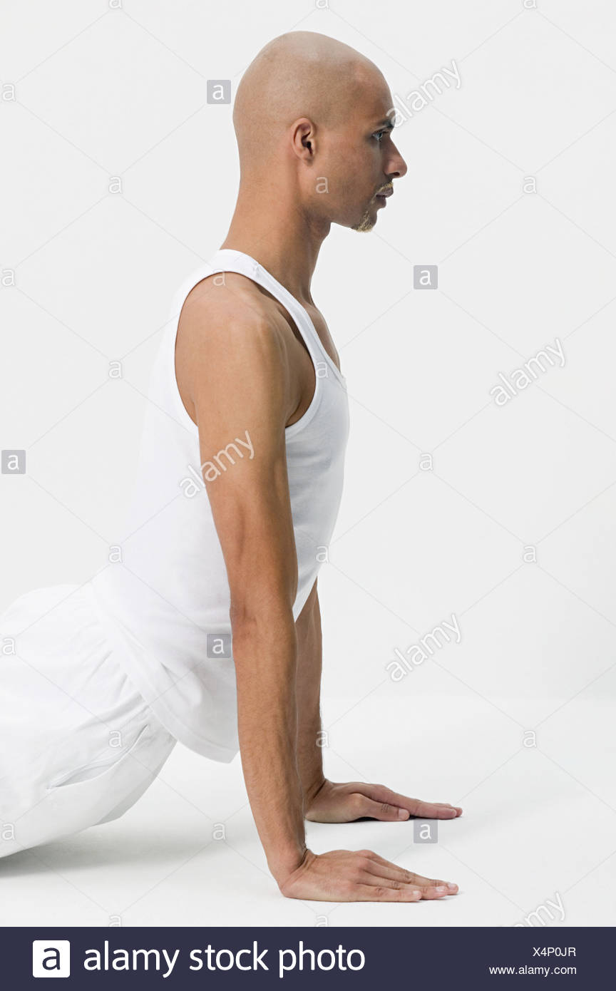 Man in a yoga pose - Stock Image