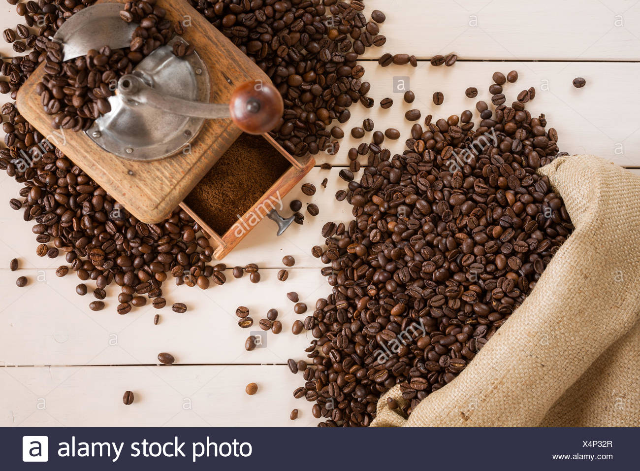 Bag of coffee and coffee grinder - Stock Image