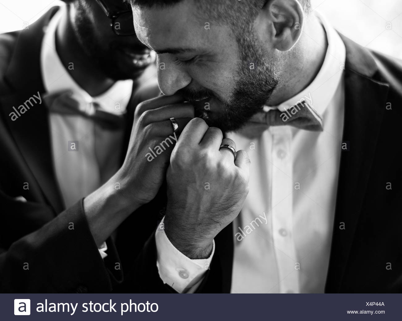 Gay Couple Kissing Hands Love Together - Stock Image
