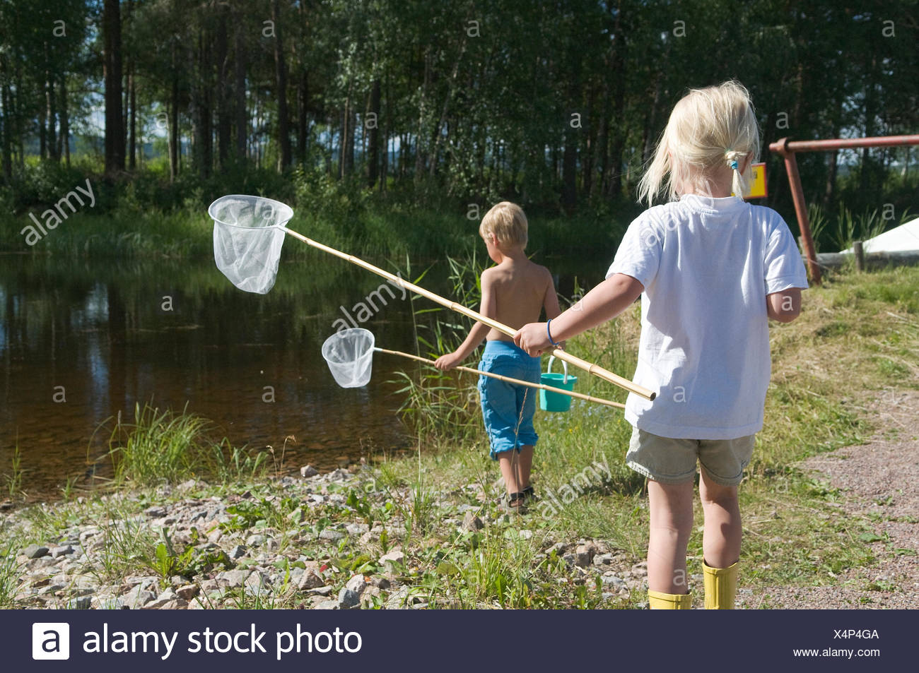 Children with butterfly-nets, Sweden. - Stock Image
