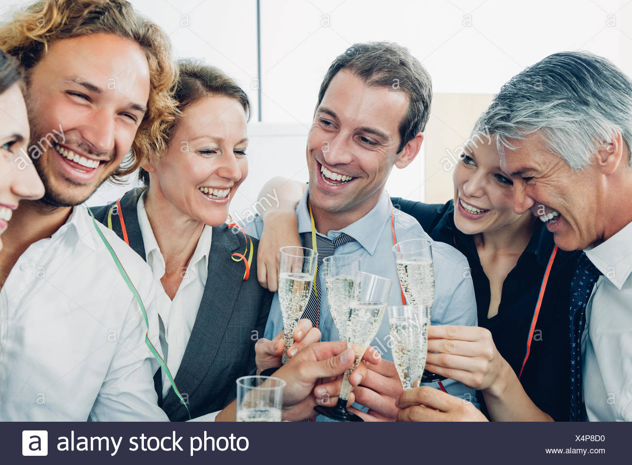 Group of business people raising a toast with champagne at office - Stock Image