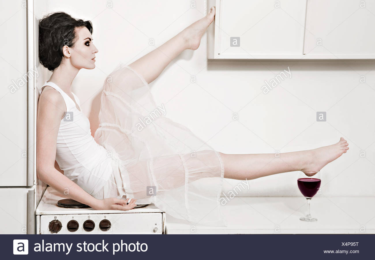 Young woman in a kitchen, Sweden. - Stock Image
