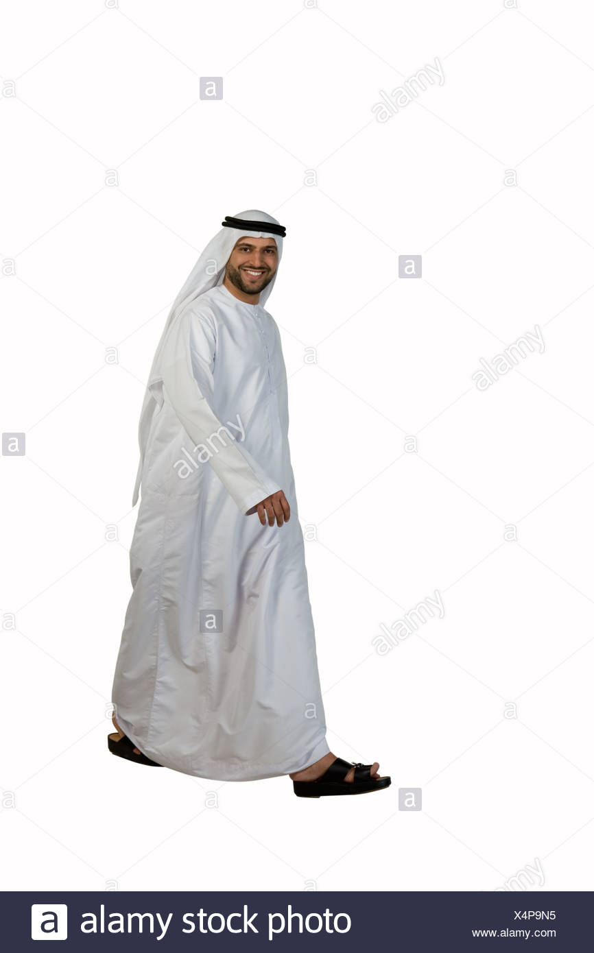 Arab man walking, smiling Stock Photo