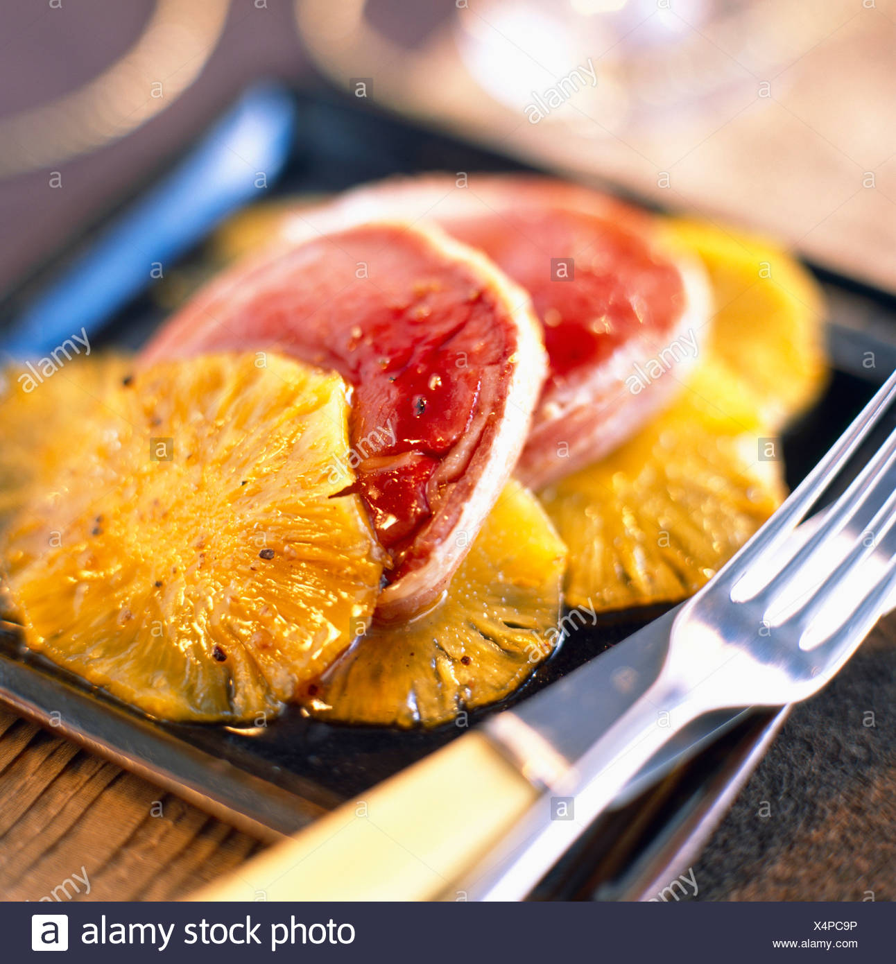 Slices of roast ostrich with pineapple - Stock Image