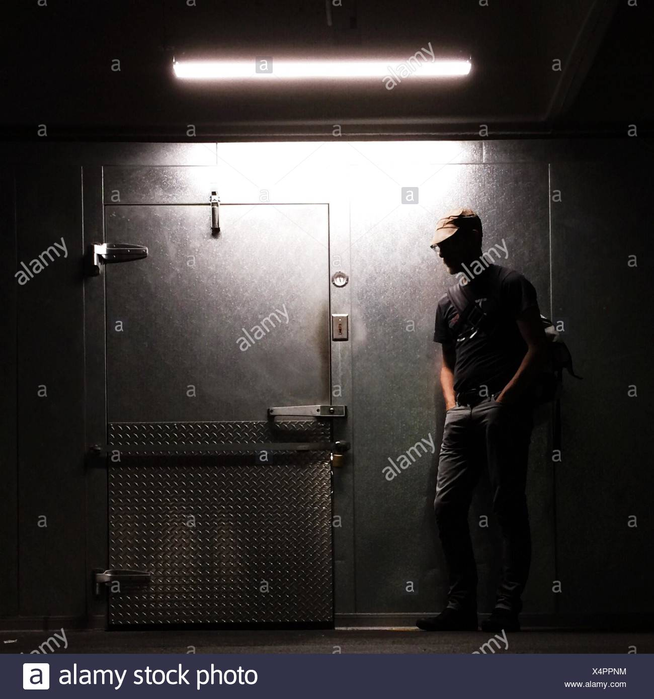 Man Looking At Locked Door - Stock Image