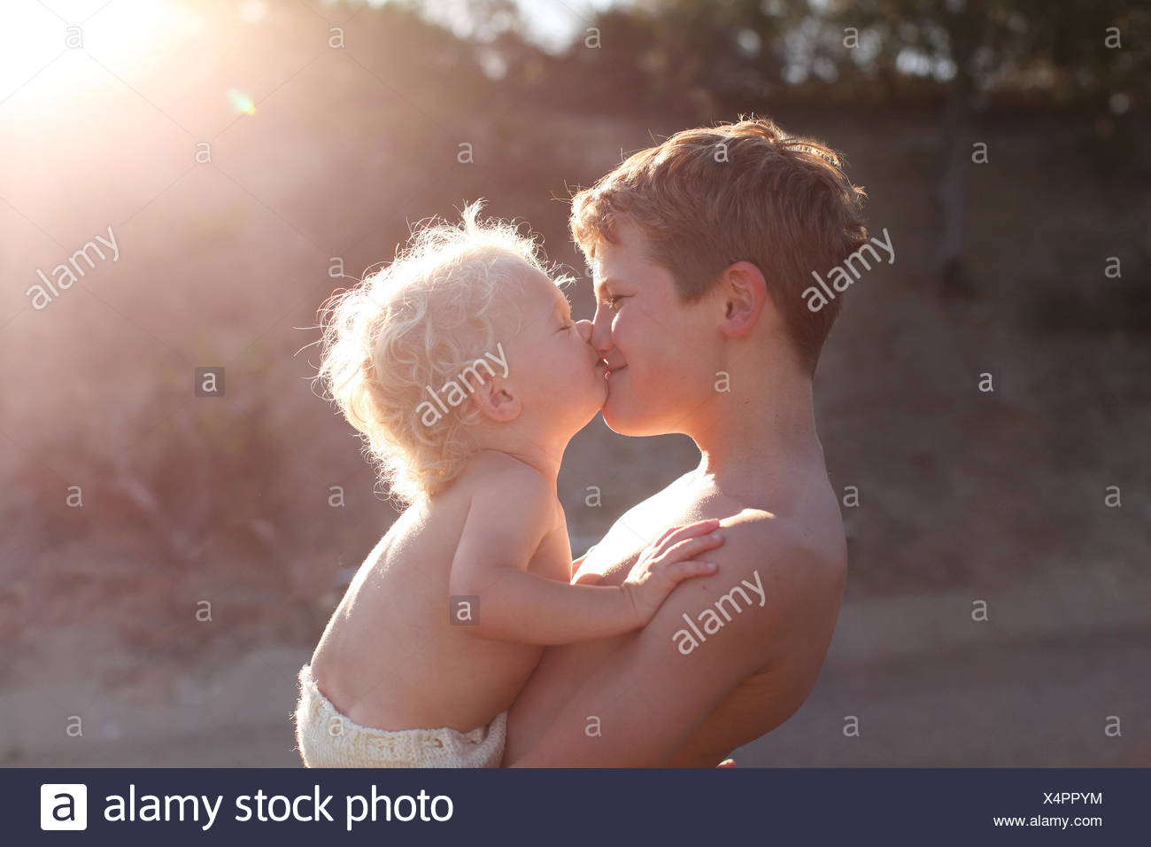 Two brothers kissing - Stock Image