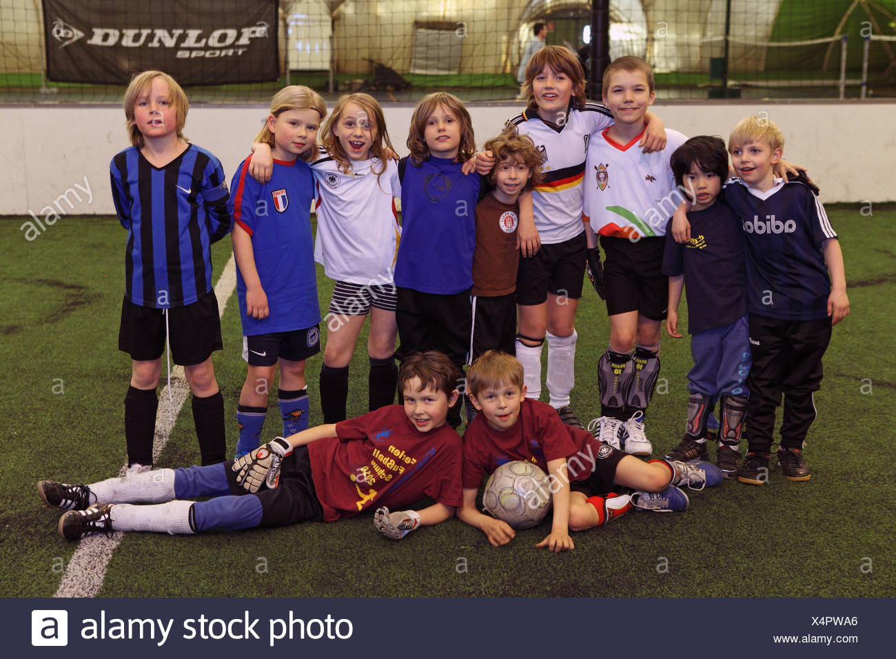 Berlin, Germany, children playing football have lined up for a group photo - Stock Image