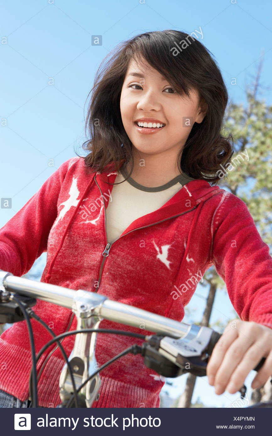 Young Woman On Mountain Bike Portrait Stock Photo
