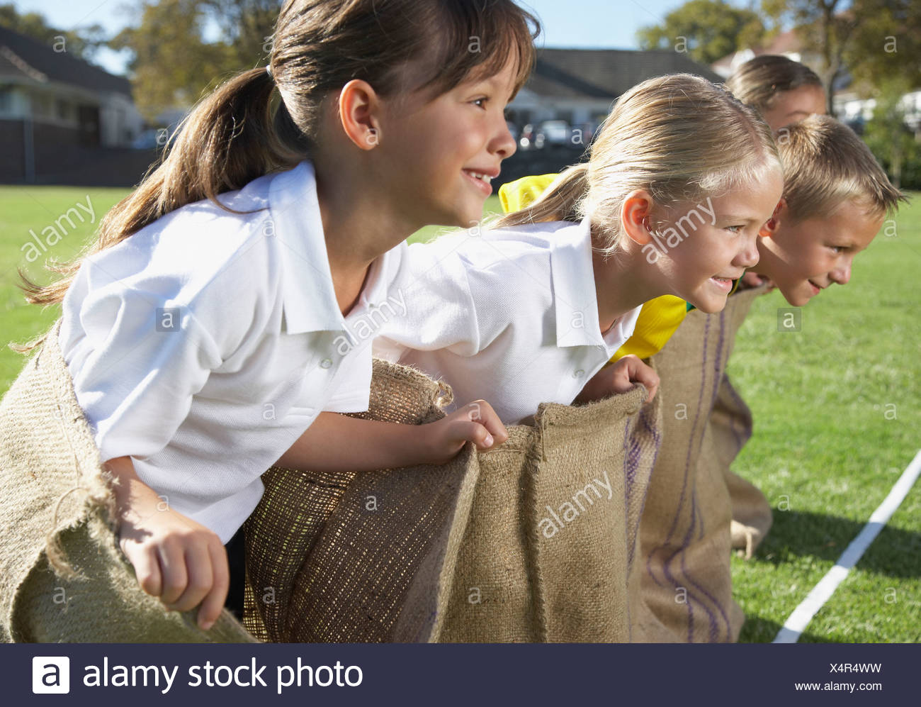 Kids potato sack racing Stock Photo