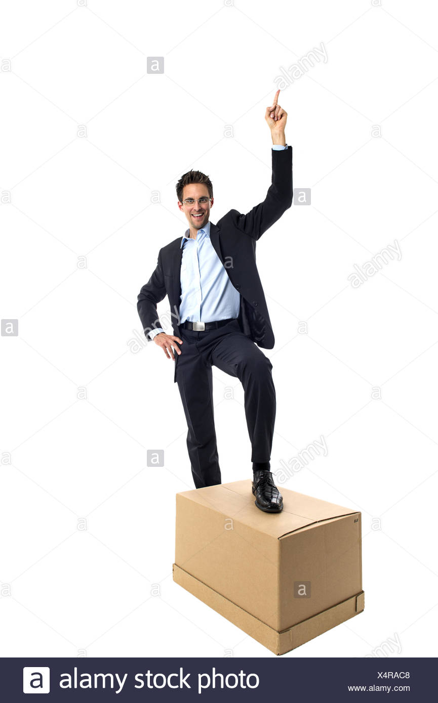 Businessman with a box Stock Photo