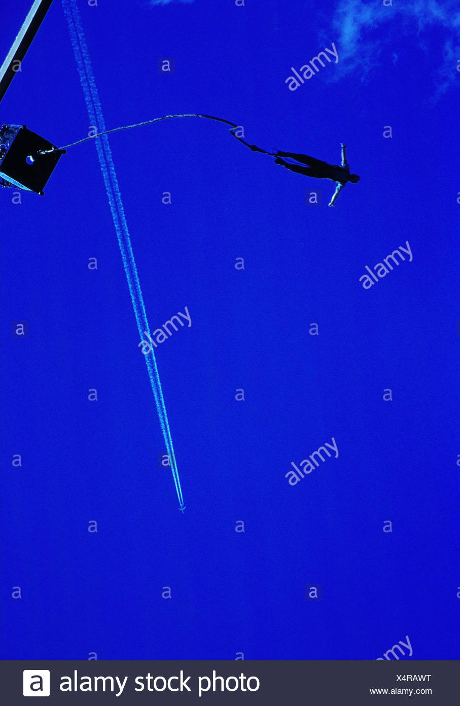 Bungeejumping, airplane, condensation trail, from below, outside, Bungee, Jumping, jumping, crack, fall, saved, crack platform, jump, man, arms, spread, risk, danger, adventure, adventure sport, thrilling, excitement, courage, heaven, blue, jump ramp, dev Stock Photo