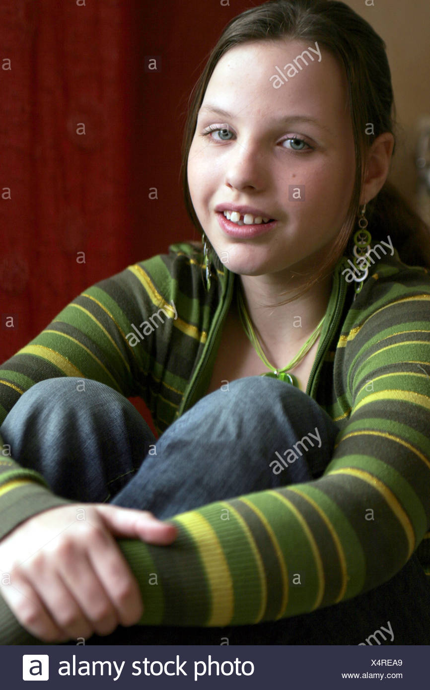 Young girl brunette looking at the camera - Stock Image