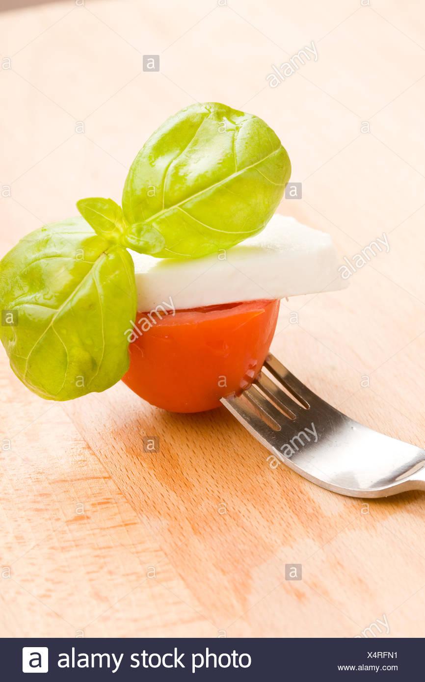 Fork with tomatoe and mozzarella - Stock Image