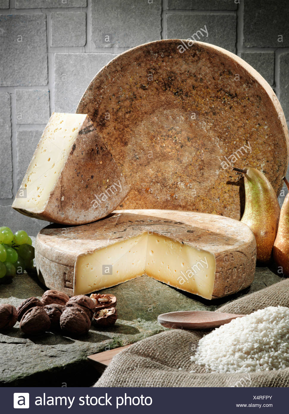 Cheese, fruit and grains on table - Stock Image