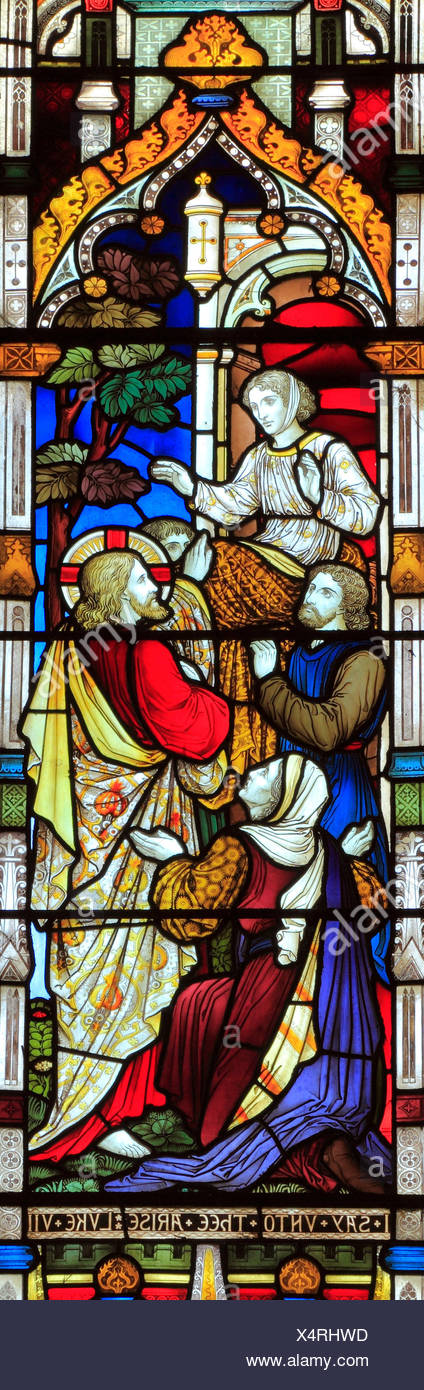 Miracles of Jesus, Say Unto Thee Arise, stained glass window, by Heaton Butler & Bayne, 1878, Swaffham, Norfolk, England, UK - Stock Image