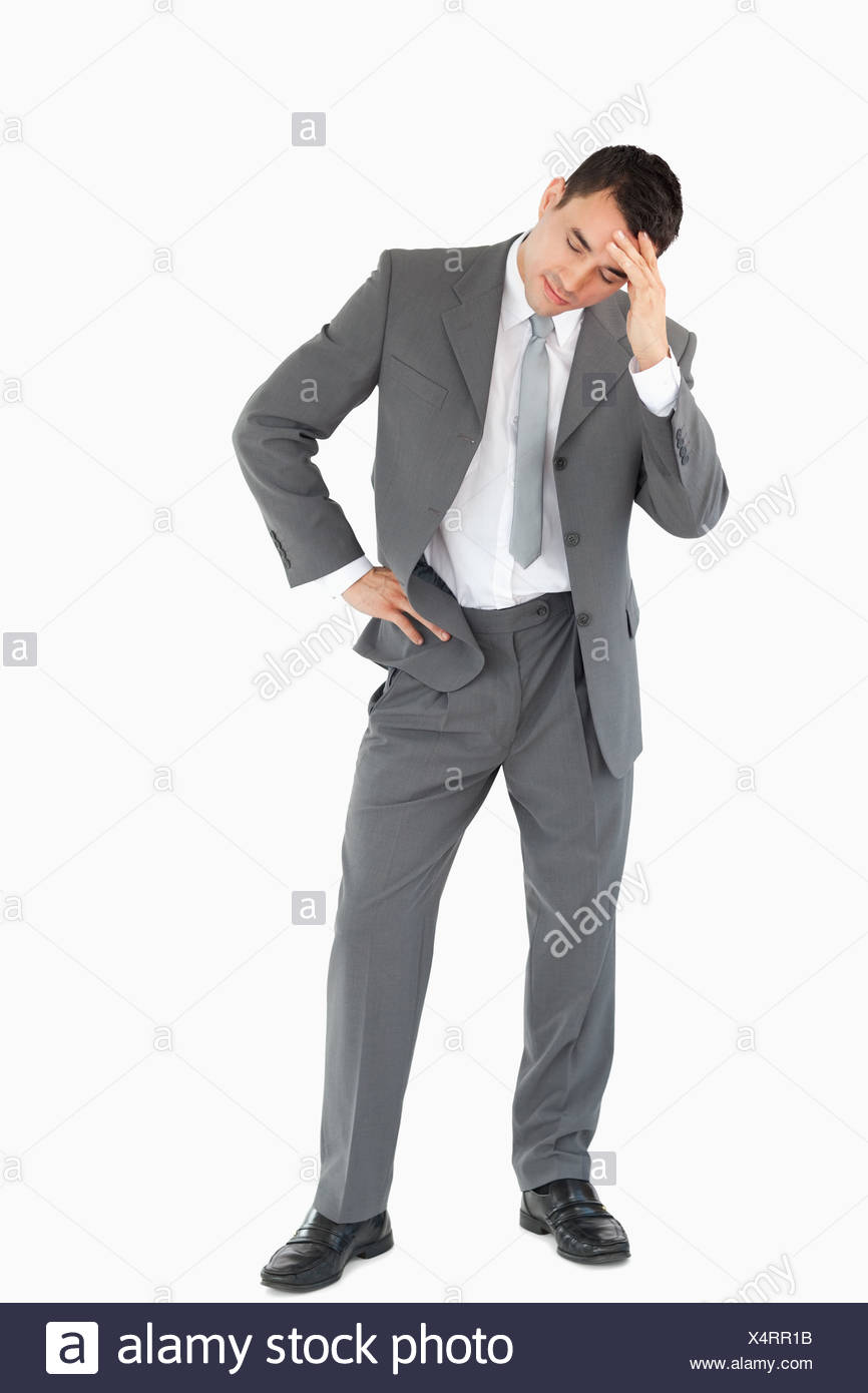 Businessman experiencing a setback - Stock Image