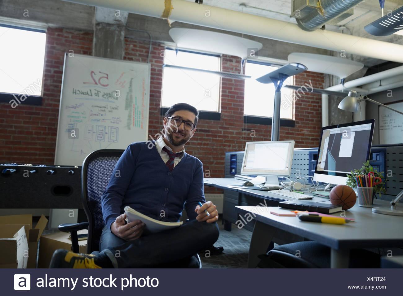 Portrait confident entrepreneur in office - Stock Image