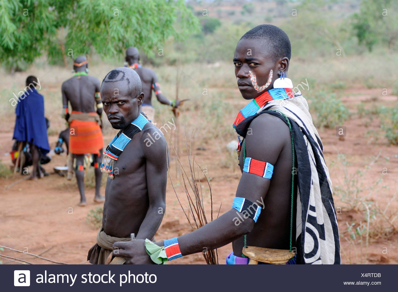 Fierce warriors from the Hamar tribe at the initiation ritual 'leap over the cattle', southern Omo valley, Ethiopia, Africa - Stock Image