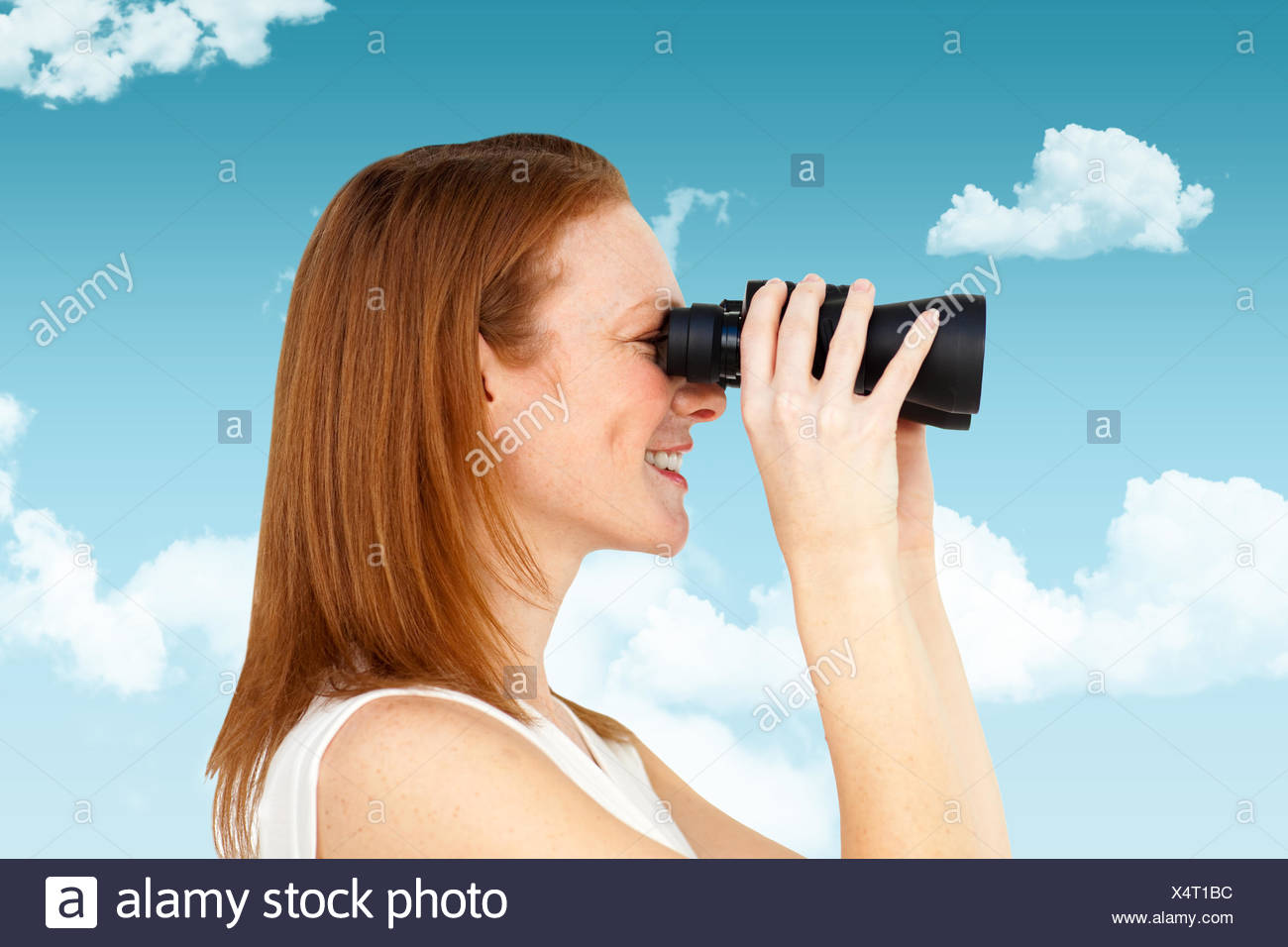 Composite image of charismatic businesswoman predicting future success - Stock Image