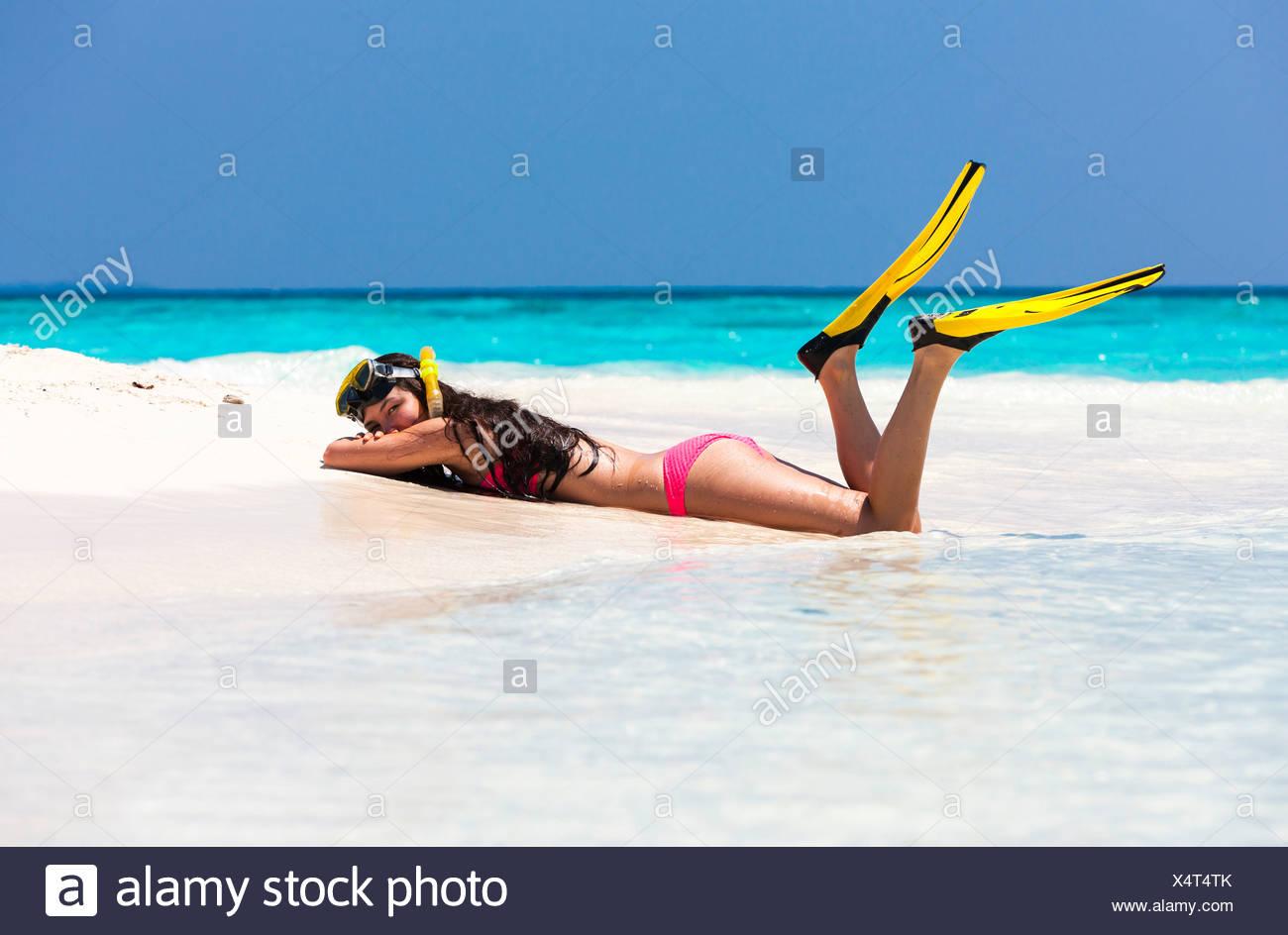 Beach woman lying on Truck drives