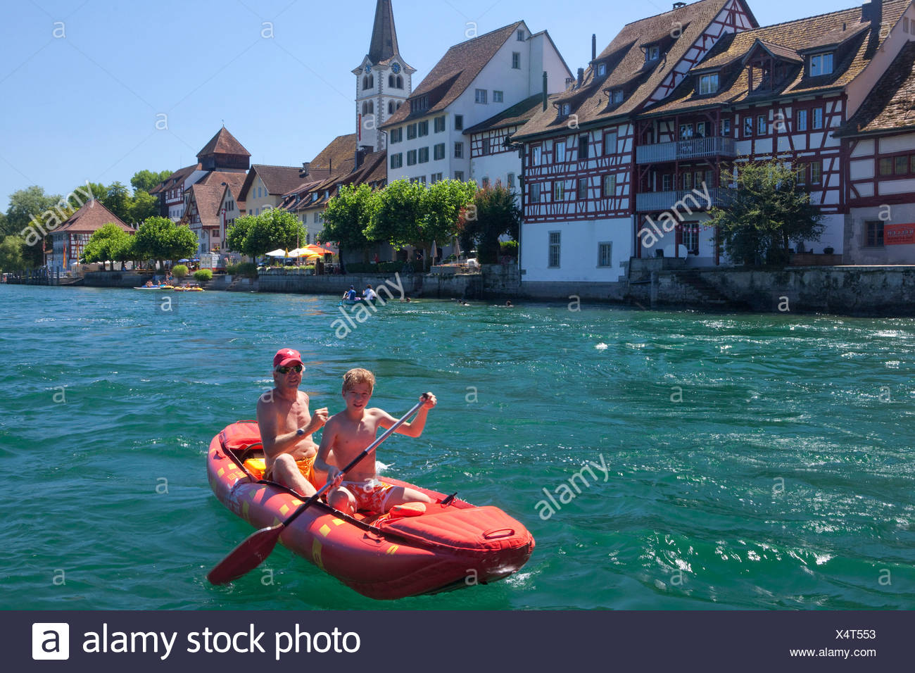 Switzerland Europe ship boat ships boats water sport boat canoe rubber dinghy life raft canton TG Thurgau father son row Rhine - Stock Image