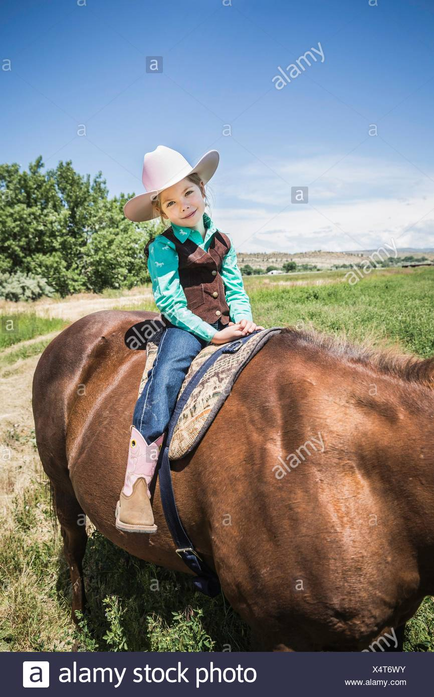 1eab4a806 Girl wearing cowboy boots and hat on horse Stock Photo: 278356791 ...