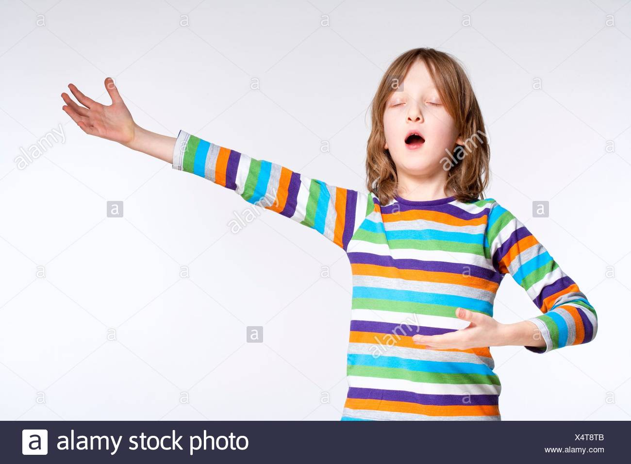 Portrait of a Boy with Blond Hair Acting as Opera Singer. Stock Photo
