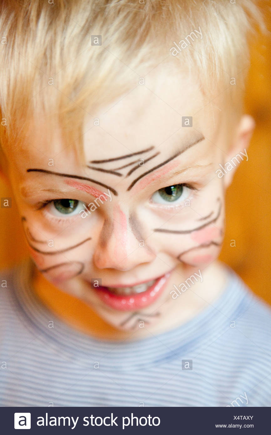 Boy with painted face - Stock Image