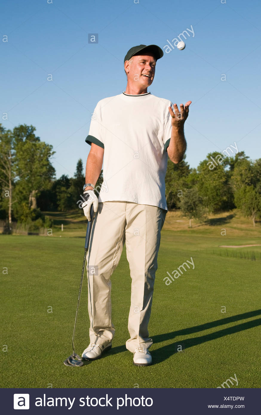 Man with golfball - Stock Image