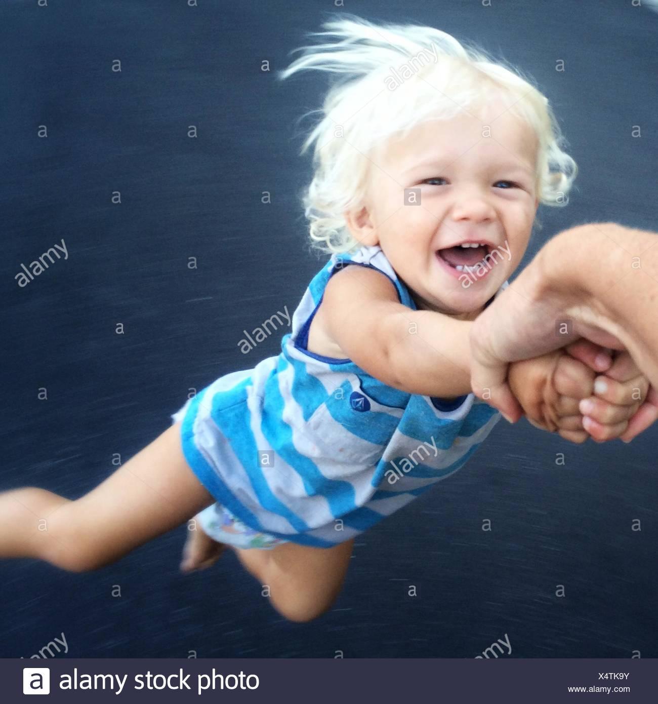 Toddler being spun around Stock Photo