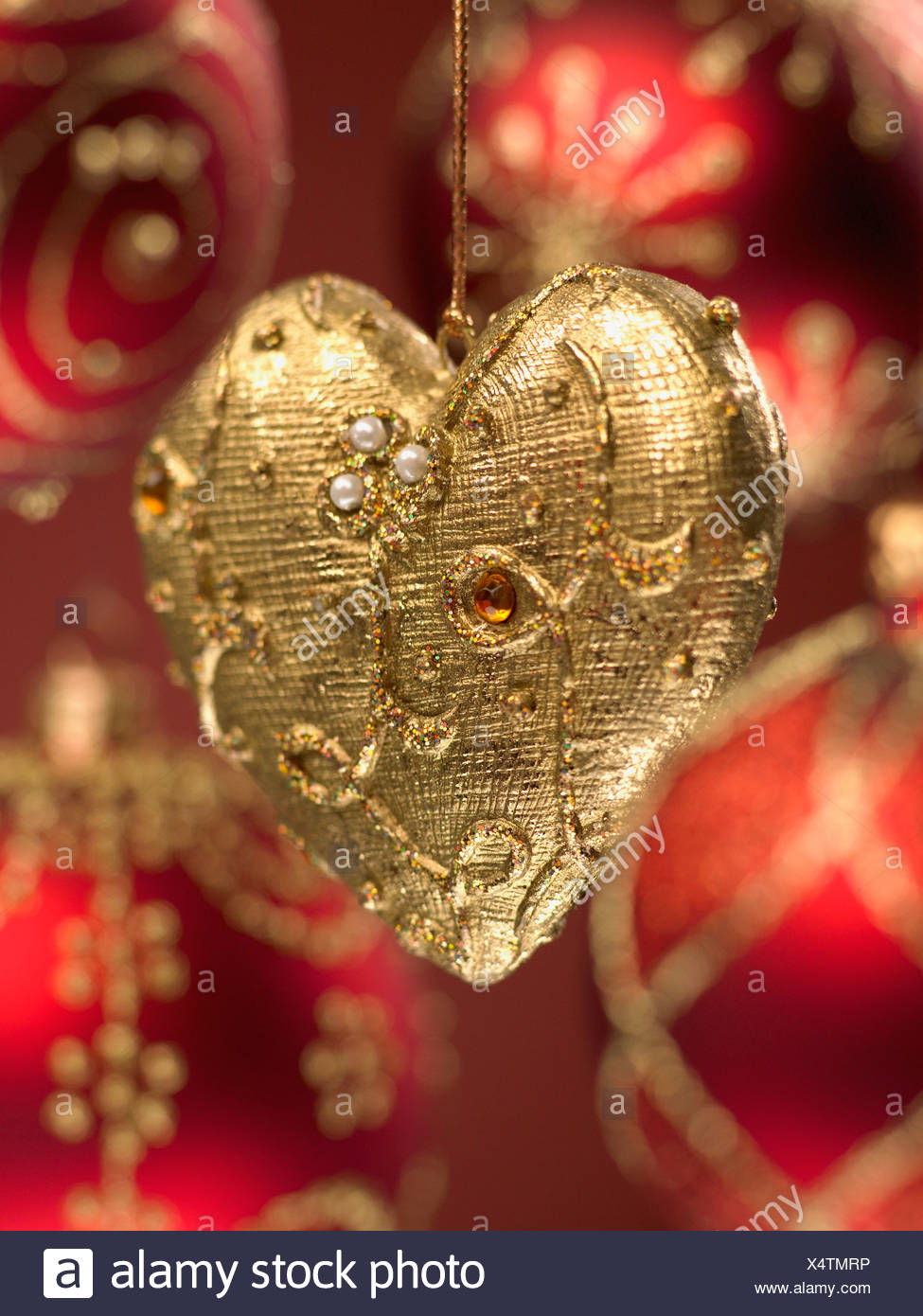 Close up of red and gold Christmas ornaments - Stock Image